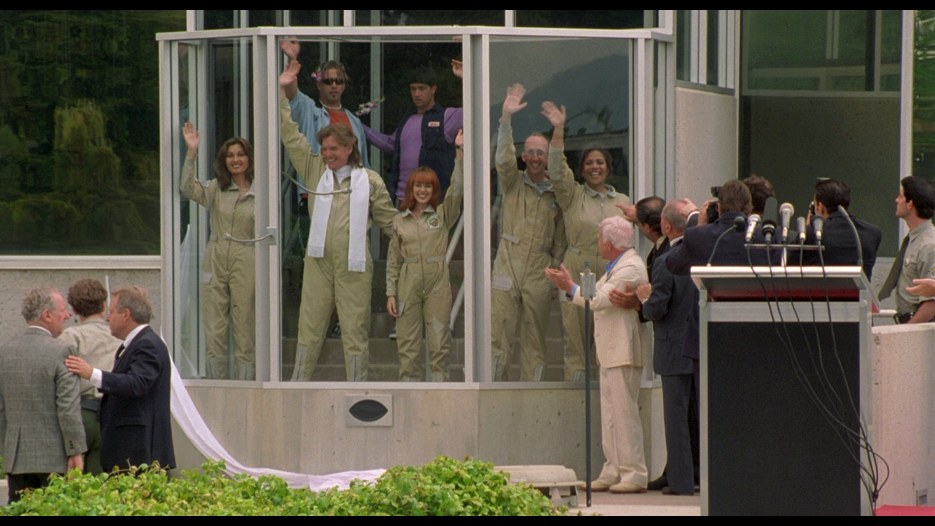 My friends and I waving to The Institutions from the bay window of my Urbit group, ~hatryx-lastud/other-life.